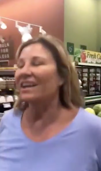 Viral Video Shows Woman Coughing On Mother and Daughter In Grocery Store